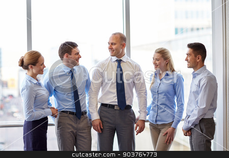 smiling business people talking in office stock photo, business, teamwork, people and technology concept - smiling business team meeting and talking in office by Syda Productions
