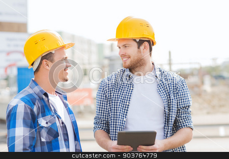 smiling builders with tablet pc outdoors stock photo, business, building, teamwork, technology and people concept - group of smiling builders in hardhats with tablet pc computer outdoors by Syda Productions