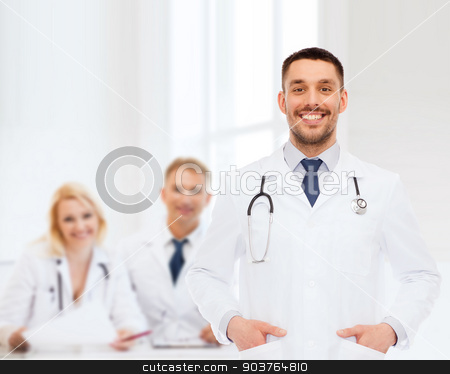 smiling male doctor with stethoscope stock photo, healthcare, profession and medicine concept - smiling male doctor with stethoscope in white coat over white background by Syda Productions