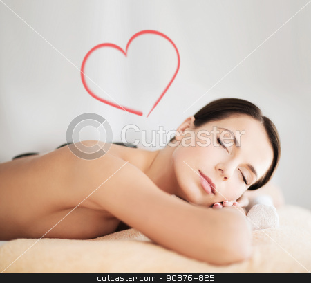 beautiful woman in spa salon with hot stones stock photo, health and beauty, resort and relaxation concept - beautiful woman with closed eyes in spa salon with hot stones by Syda Productions