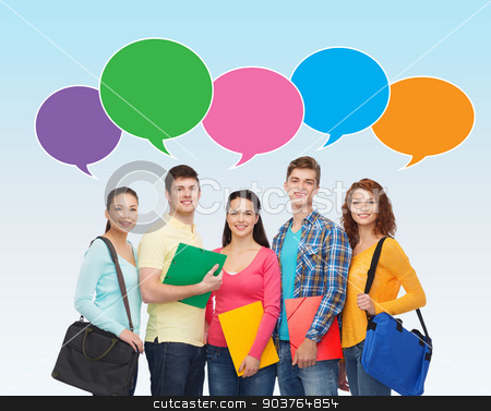 group of smiling students with text bubbles stock photo, school, education, communication and people concept - group of smiling students with folders and school bags over blue background with text bubbles by Syda Productions