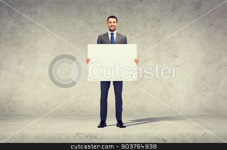smiling businessman with white blank board stock photo, business, education, office and advertising concept - smiling businessman with big white blank board by Syda Productions