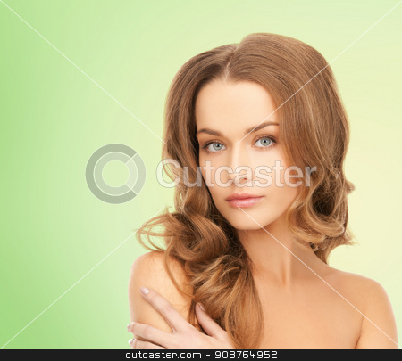 beautiful young woman with bare shoulders stock photo, beauty, people and health concept - beautiful young woman with bare shoulders over green background by Syda Productions
