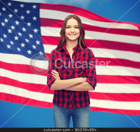 smiling young woman in casual clothes stock photo, happiness and people concept - smiling young woman in casual clothes with crossed arms by Syda Productions