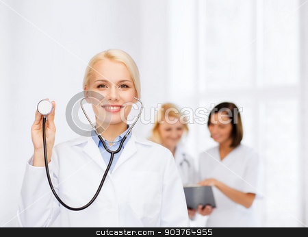 smiling female doctor with stethoscope stock photo, healthcare and medicine concept - smiling female doctor with stethoscope by Syda Productions