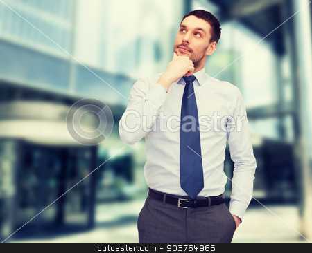 handsome businessman looking up stock photo, business and office concept - handsome businessman looking up by Syda Productions