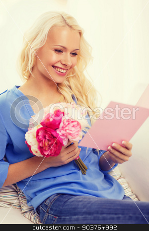 smiling woman with card and bouquet of flowers stock photo, holiday, celebration, home and birthday concept - smiling young woman with greeting card and bouquet of flowers by Syda Productions