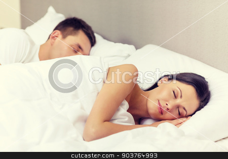 happy couple sleeping in bed stock photo, hotel, travel, relationships, and happiness concept - happy couple sleeping in bed by Syda Productions