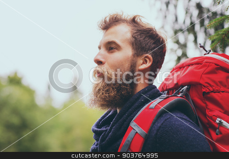 smiling man with beard and backpack hiking stock photo, adventure, travel, tourism, hike and people concept - smiling man with beard and red backpack hiking by Syda Productions