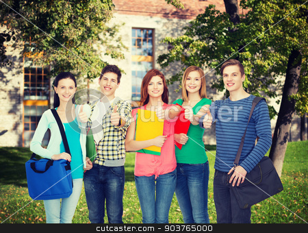 group of smiling students standing stock photo, education and people concept - group of smiling students standing by Syda Productions