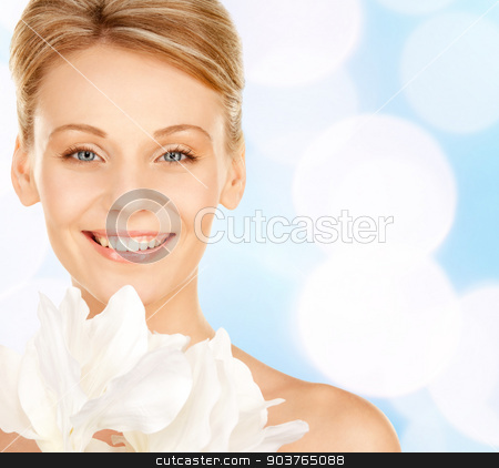 beautiful young woman with bare shoulders stock photo, beauty, people and health concept - beautiful young woman with bare shoulders over blue lights background by Syda Productions