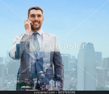 smiling businessman with smartphone in city stock photo, business, technology, communication and people concept - smiling businessman with smartphone talking over city background by Syda Productions