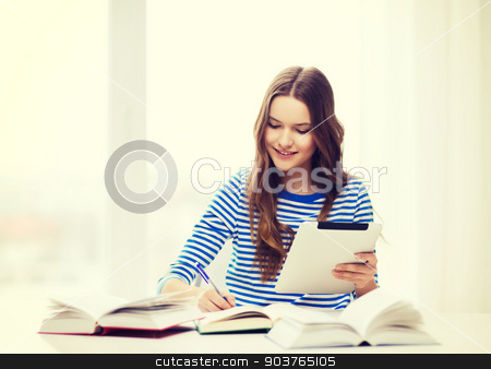 smiling student girl with tablet pc and books stock photo, education, technology and home concept - happy smiling student girl with teablet pc computer and books at home by Syda Productions