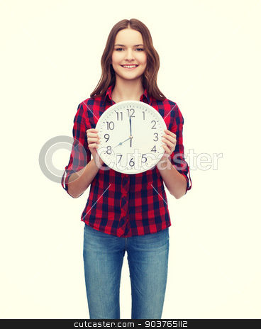 young woman in casual clothes with wall clock stock photo, happiness and people concept - smiling young woman in casual clothes with wall clock showing 8 oclock by Syda Productions