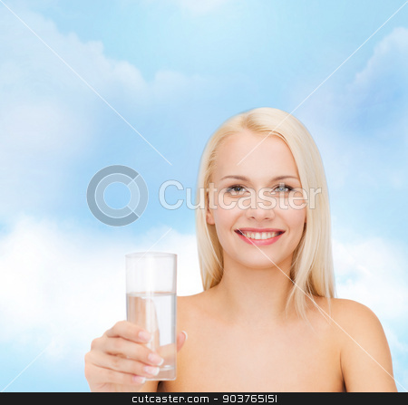 young smiling woman with glass of water stock photo, health and beauty concept - closeup of young smiling woman with glass of water by Syda Productions