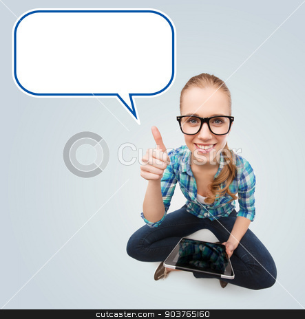smiling teen girl sitting on floor with tablet pc stock photo, communication, technology, internet, gesture and people concept - smiling teenage girl in eyeglasses holding tablet pc computer and showing thumbs up over gray background with blank white text bubble by Syda Productions