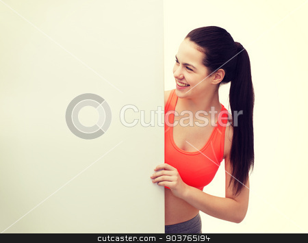 teenage girl in sportswear with white board stock photo, fitness and diet concept - smiling teenage girl in sportswear with white blank board by Syda Productions