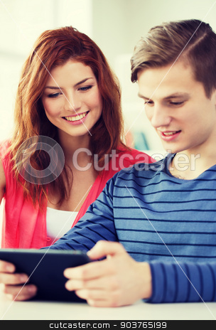 smiling students with tablet pc at school stock photo, education, technology and internet concept - smiling students with tablet pc computers at school by Syda Productions