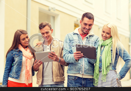 group of smiling friends with tablet pc computers stock photo, travel, vacation, technology and friendship concept - group of smiling friends with tablet pc computers in the city by Syda Productions