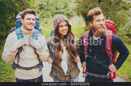 group of smiling friends with backpacks hiking stock photo, adventure, travel, tourism, hike and people concept - group of smiling friends with backpacks outdoors by Syda Productions