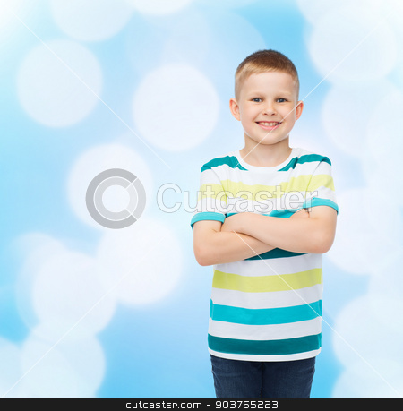 little boy in casual clothes with arms crossed stock photo, happiness, childhood and people concept - smiling little boy in casual clothes with crossed arms over blue background by Syda Productions