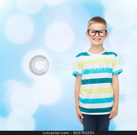 smiling little boy in eyeglasses stock photo, vision, education and school concept - smiling little boy in eyeglasses over blue background by Syda Productions