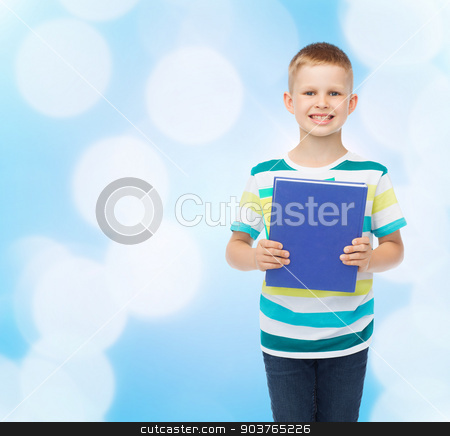 smiling little student boy with blue book stock photo, education, childhood and school concept - smiling little student boy with book over blue background by Syda Productions