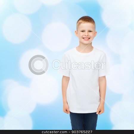 smiling little boy in white blank t-shirt stock photo, advertising, people, childhood and people concept - smiling little boy in white blank t-shirt over blue background by Syda Productions