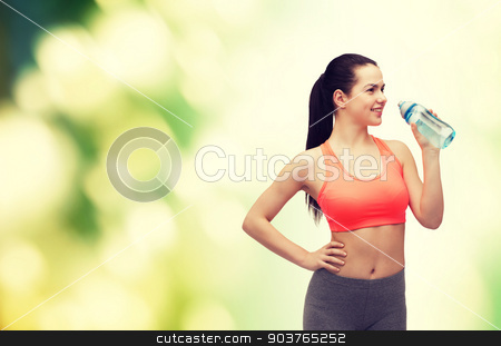 sporty woman with water bottle stock photo, sport, exercise and healthcare - sporty woman with water bottle by Syda Productions