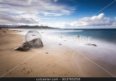 Lozari beach near Ile Rousse in Corsica stock photo, Slow shutter speed shot of Lozari beach in the Balagne region of northern Corsica with Ile Rousse in the background by Jon Ingall