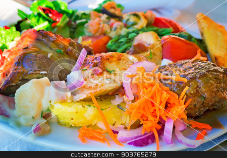 Stews and side dishes from a variety of vegetables. stock photo, On the table on a platter lies stews and side dishes from a variety of vegetables: carrots, onions, lettuce, tomatoes. by Georgina198