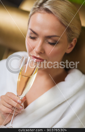 beautiful young woman drinking champagne at spa stock photo, people, beauty, lifestyle, holidays and relaxation concept - beautiful young woman in white bath robe drinking champagne at spa by Syda Productions