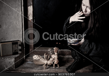 broken home stock photo, young girl on an old window sill in dirty clothes by Suchota