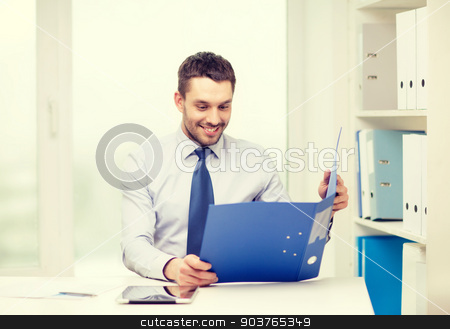 businessman with folder and tablet pc computer stock photo, business, office and technology concept - smiling businessman with folder and tablet pc computer at office by Syda Productions