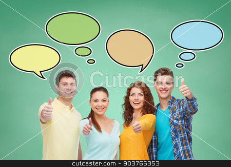 group of smiling teenagers with text bubbles stock photo, school, education, communication, gesture and people concept - group of smiling teenagers showing thumbs up over green board background with text bubbles by Syda Productions