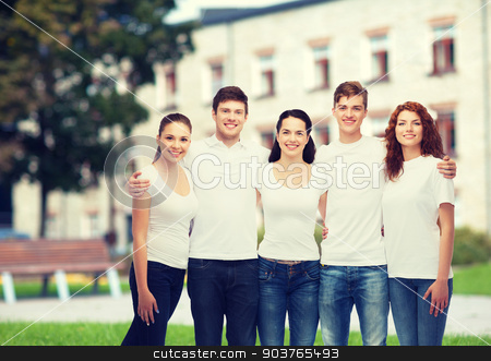 group of smiling teenagers in white blank t-shirts stock photo, advertising, friendship, education, scool and people concept - group of smiling teenagers in white blank t-shirts over campus background by Syda Productions