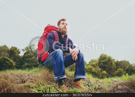 man with backpack hiking stock photo, adventure, travel, tourism, hike and people concept - smiling man with red backpack sitting on ground by Syda Productions