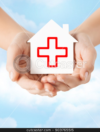 hands holding paper house with red cross stock photo, healthcare, medicine and charity concept - hands holding white paper house with red cross sign by Syda Productions