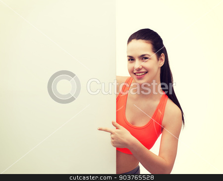 teenage girl in sportswear with white board stock photo, fitness and diet concept - smiling teenage girl in sportswear pointing finger to white blank board by Syda Productions
