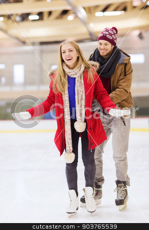 happy couple on skating rink stock photo, people, friendship, sport and leisure concept - happy couple on skating rink by Syda Productions
