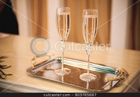 wedding champagne glass full of drink stock photo, wedding champagne glass with hearts  full of drink by Maksym Fesenko
