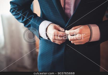 men fastens his black suit  stock photo, men fastens his black suit no face  by Maksym Fesenko