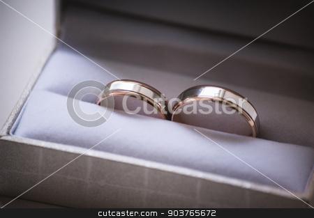 wedding rings in grey box stock photo, two wedding rings in grey box with bow by Maksym Fesenko