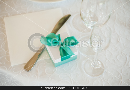 box with green bow on table  stock photo, wedding gift box with green bow on table  by Maksym Fesenko