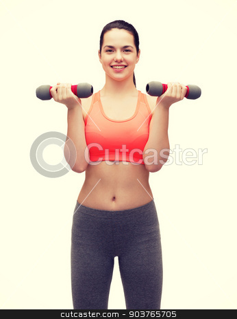 young sporty woman with light dumbbells stock photo, sport, excercising and healthcare concept - young sporty woman with light dumbbells by Syda Productions