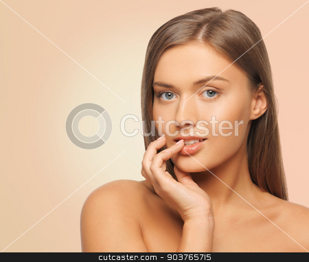 beautiful young woman face stock photo, beauty, people and health concept - beautiful young woman touching her face over pink background by Syda Productions