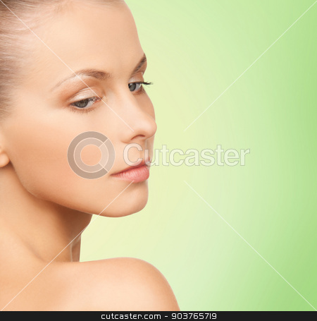 beautiful young woman face stock photo, beauty, people and health concept - beautiful young woman face over green background by Syda Productions