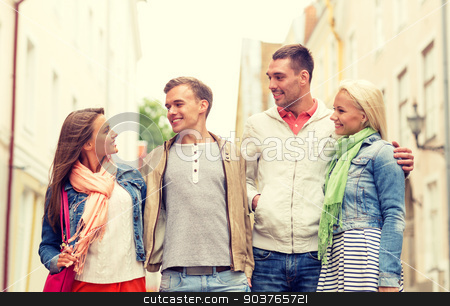 group of smiling friends walking in the city stock photo, friendship, travel and vacation concept - group of smiling friends walking in the city by Syda Productions