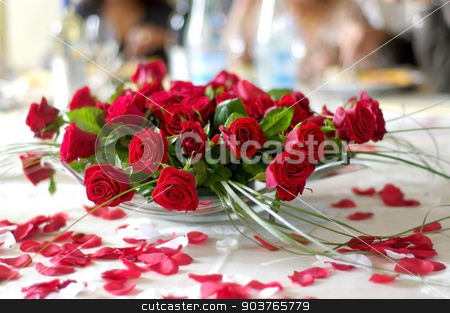 red roses for the bride and groom stock photo, red rose petals on the table newlyweds by Piermichele Malucchi