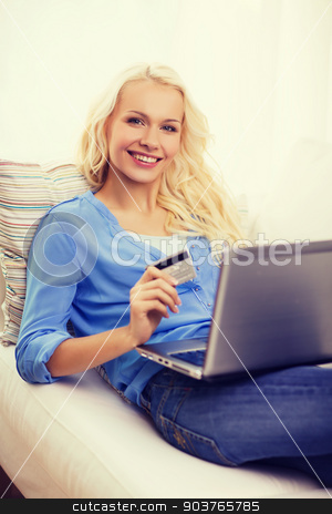 smiling woman with laptop computer and credit card stock photo, online shopping, banking and technology concept - smiling young woman with laptop computer and credit card by Syda Productions